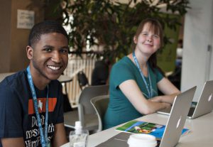 Young man and young woman with laptops at WordCamp Minneapolis